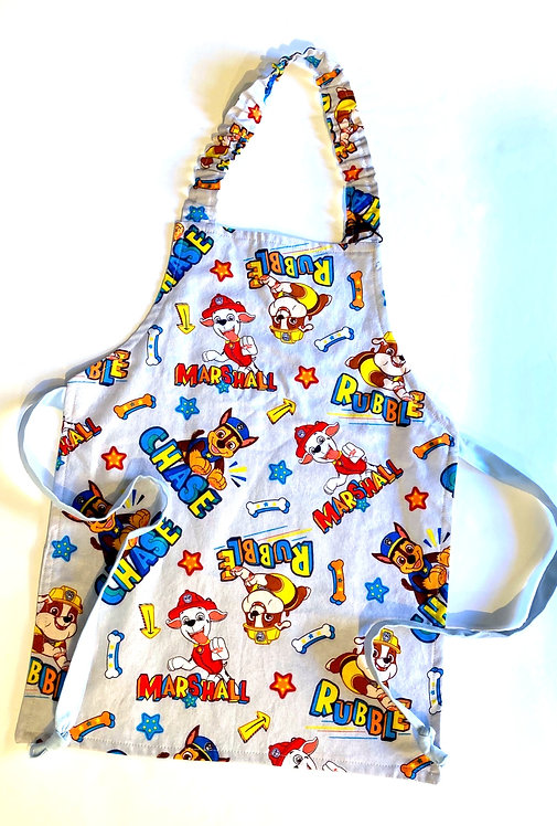 Front view of child's apron - red, yellow & blue Paw Patrol print