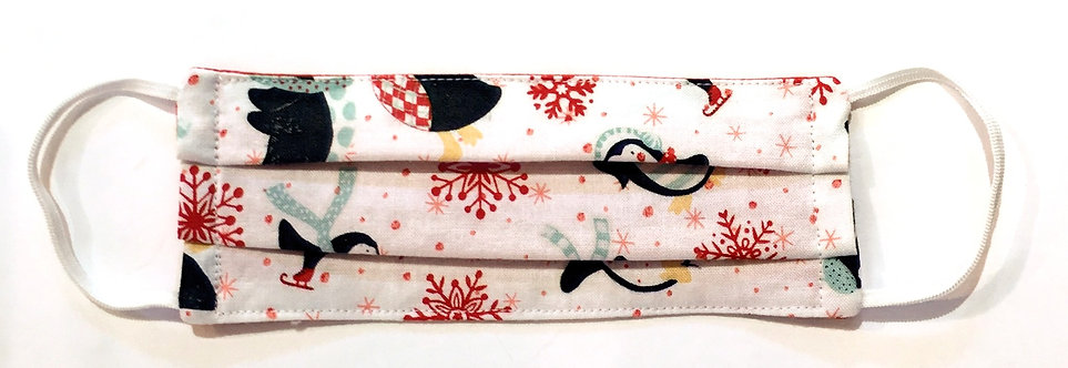 Tiny pink cotton mask laid flat with black & red skating penguins & snowflakes print