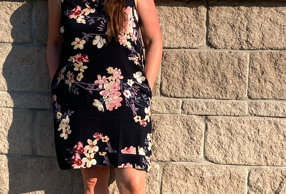Jill wearing knee-length black floral print loose A-line sleeveless dress with V-neck