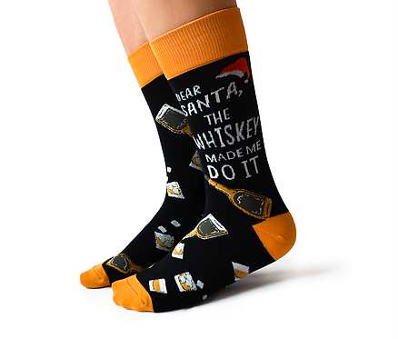 Side view of pair of black socks with yellow cuff-toe-heel & text 'Dear Santa, the whiskey made me do it''