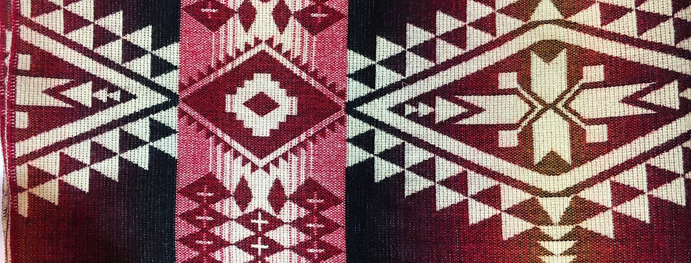Close up of red& white patterned blanket