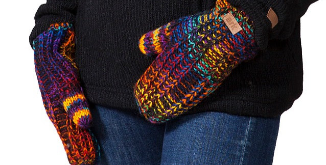 Model wearing blended rainbow striped wool knit mitts