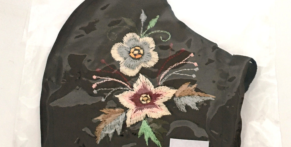Side view of folded embroidered dark brown cotton mask with 2 flowers in cream & gray with silver, bronze & green leaves