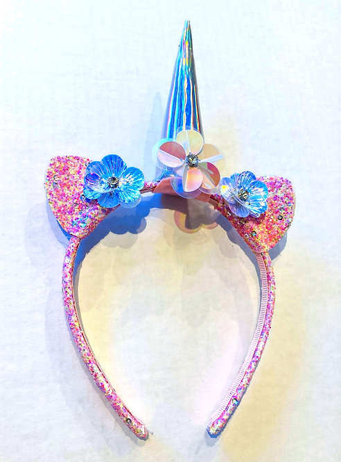 Front view of sparkly pink & light blue headband with flowers,  unicorn ears & horn