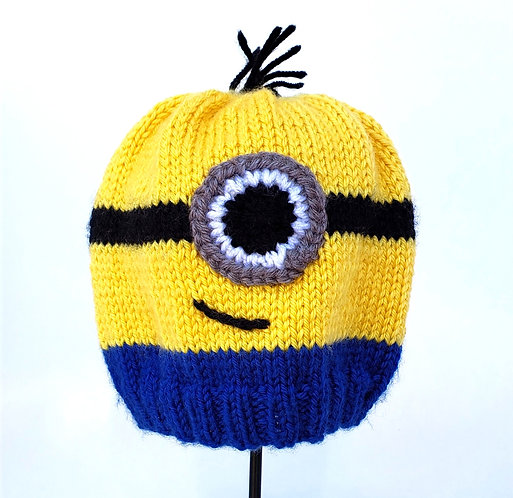 Yellow beanie style Marshmallow Marlie Hand Knit Infant Hat - Minion eye on front, blue stripe around  ribbed edge