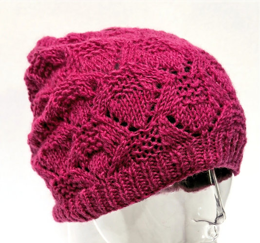 Solid magenta intricate pattern knit wool hat with ribbed rim