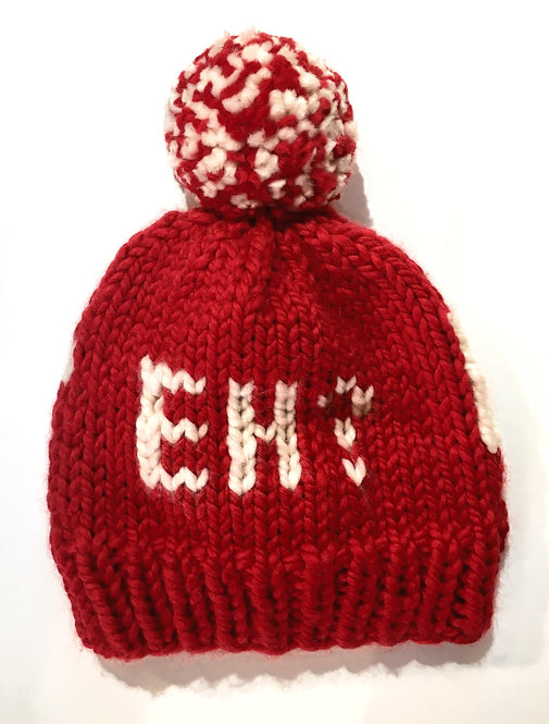 red knit toque with red&white pompom and the word 'Eh?' on the side