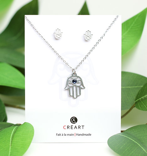 Green and white card displaying pewter chain, pendant and stud earring set in shape of hand of fatima