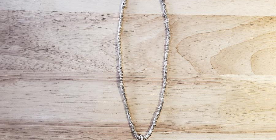 Long rough cut quartz crystal pendant on a natural beige hemp necklace