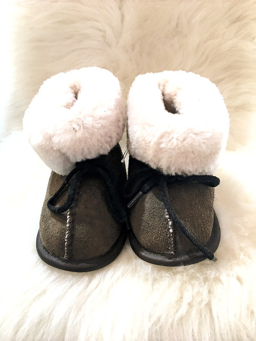 Front view of Brown sheepskin slippers with white fleece showing on folded down cuffs, laces