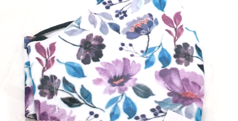 Side view of folded white mask with teal,purple &magenta floral print