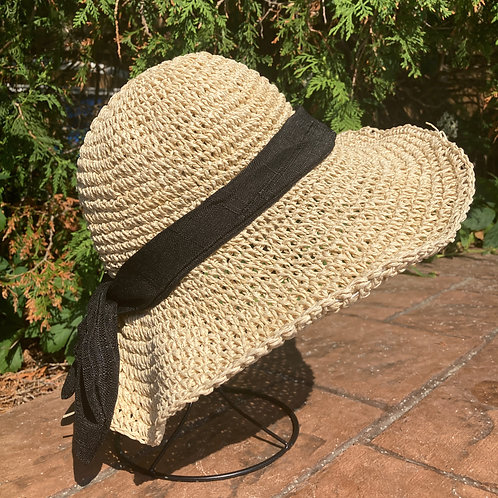 Side view of floppy brim hat on stand