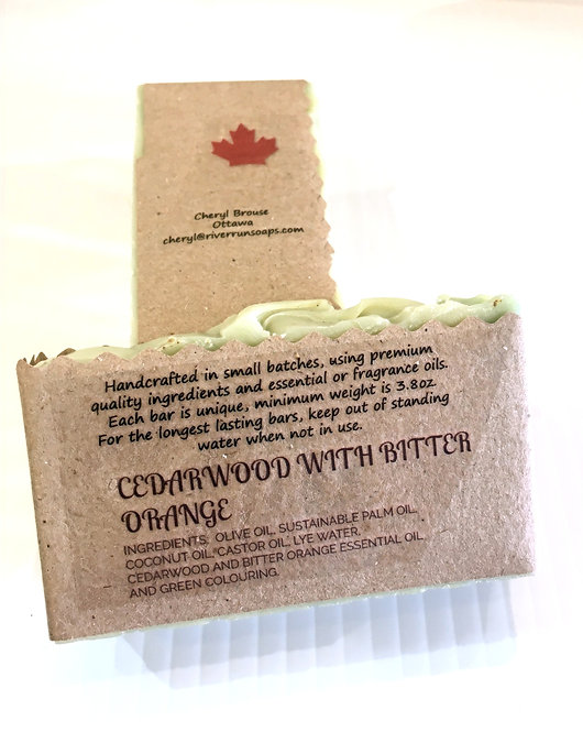 2 bars of sandalwood scented handmade soap in kraft paper wrapper printed with ingredients and Made in Canada