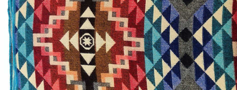 Close up of multi-colored geometric patterned blanket