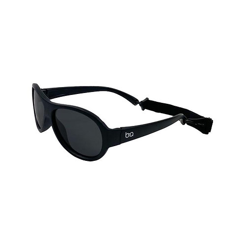 Angled side view of black aviator style sunglasses for babies with head strap