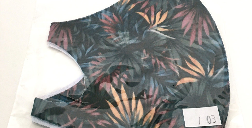 Side view of folded navy blue face mask with teal, ochre & aubergine floral print