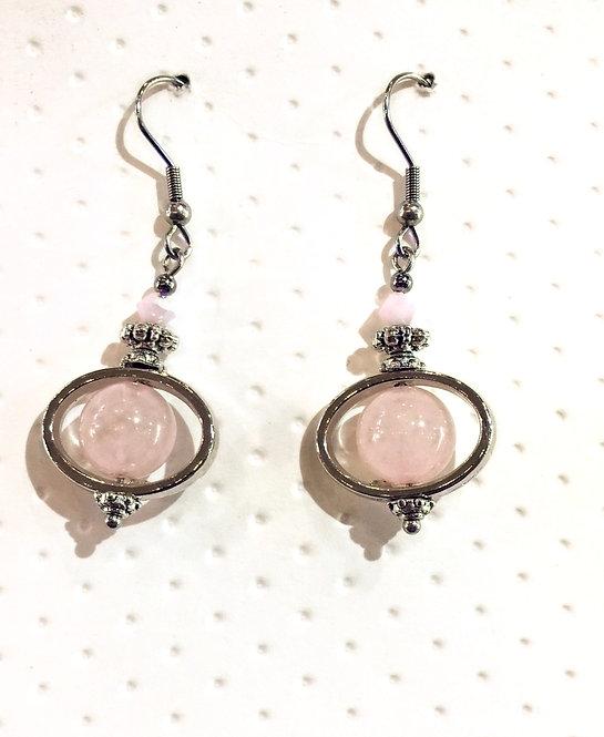 Pair of platinum-colored earrings with 10mm round rose quartz stones