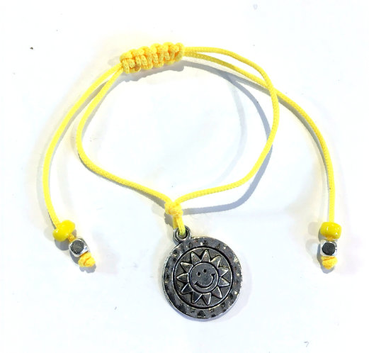 Metal smiling sun charm bracelet on adjustable knotted yellow cord with yellow & silver beads at ends