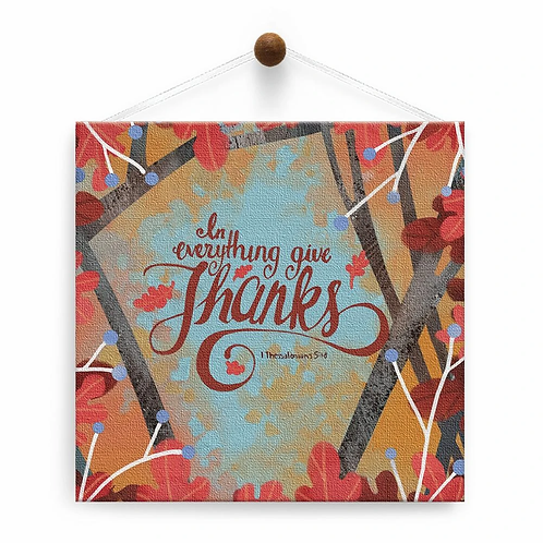 square card-orange leaves-text says 'In everything give Thanks' hanging from a thumbtack