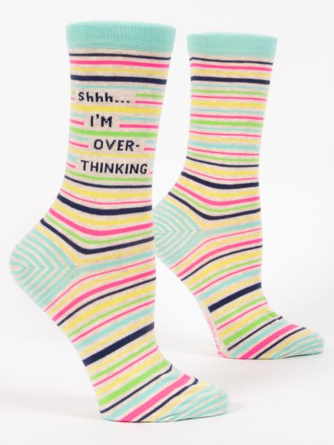 Side view of pale green socks with red, black & yellow stripes, text 'Shhh, I'm Overthinking'