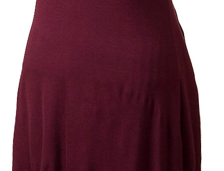 Mannequin showing plum round neck knee-length sleeveless dress with long points at sides of hemline