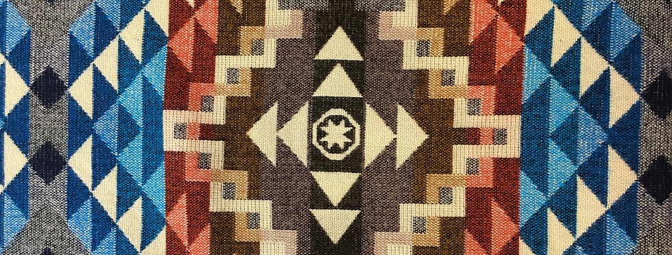 Close up of brown geometric patterned blanket