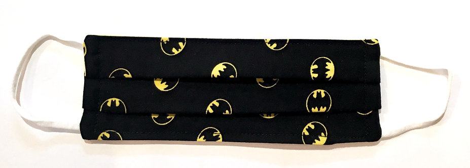 Tiny black cotton mask laid flat with yellow batman light signal print