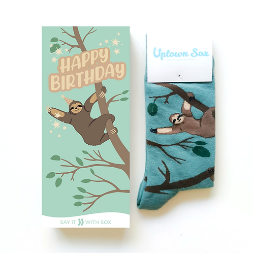 Green card with sloth hanging from vine-text 'Happy Birthday.' & a paid of green socks with sloth print