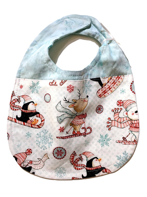 blue & white oval-shaped cloth baby bib with animals & candy canes in red, white & black