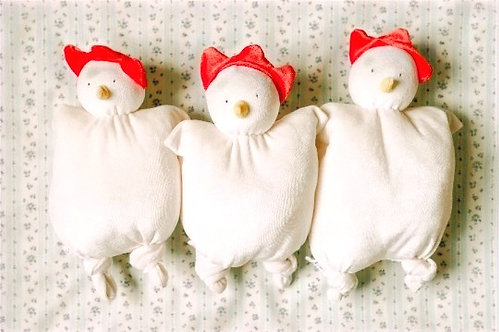 3 white rudimentary stuffed chicken toys with red combs for infants
