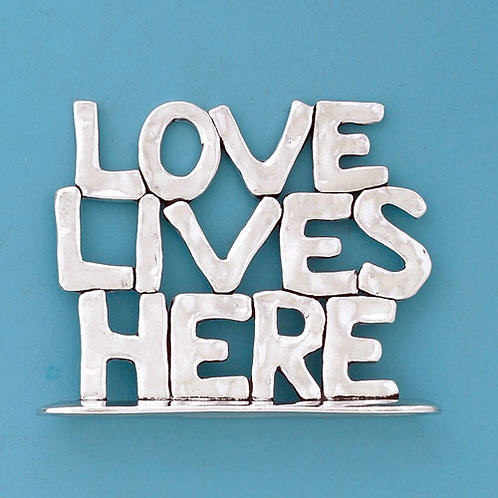 Pewter plaque with stacked words 'LOVE LIVES HERE'