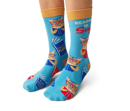 Front view of feet wearing blue socks with red & brown images of cats reading books-text-SHAKESPURR &PAWS