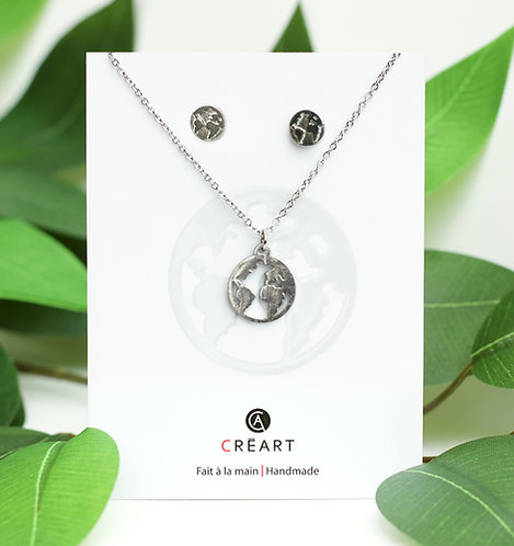 Green and white card displaying pewter Earth pendant and stud earring set