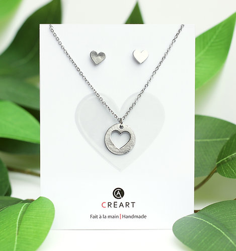 Green & white card displaying pewter chain, pendant & stud earrings set in heart shape