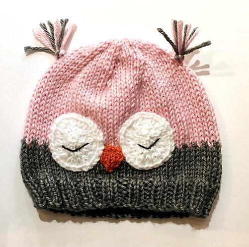 Knit infant cap half pink half gray, 2 sleeping owl eyes & beak stitched on