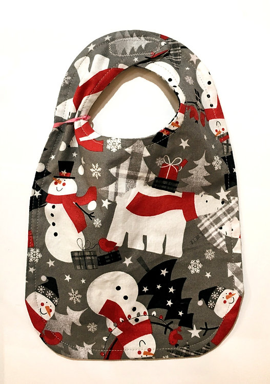 gray oval-shaped cloth baby bib with polar bears & snowmen in red, white & black