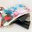 small colorful rectangular purse laying flat
