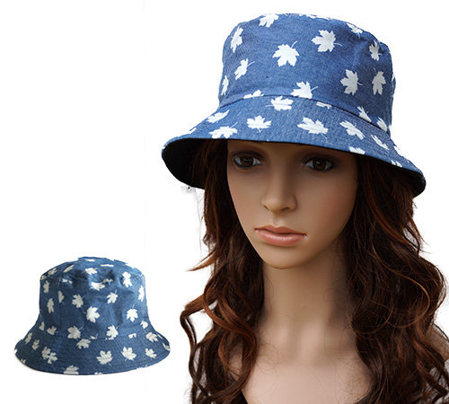 Maple Leaf Women's Bucket Hat with white maple leaves on sky blue background on mannequin