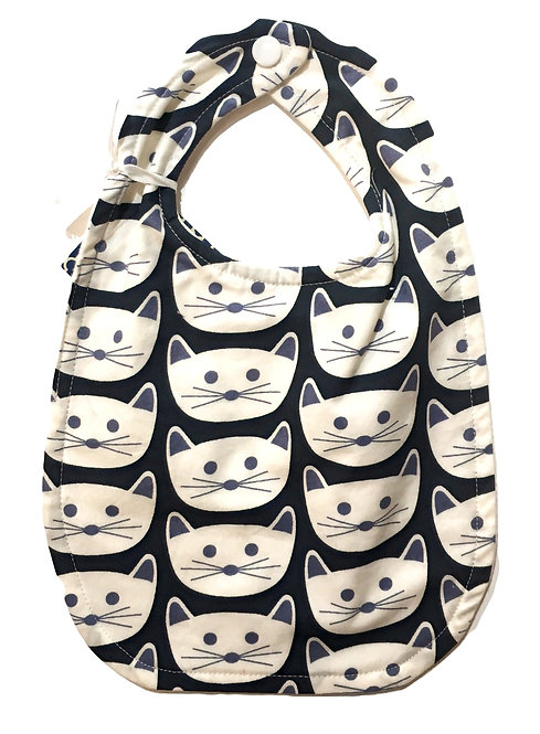 Dark blue oval shaped cotton bib with print of white cat faces
