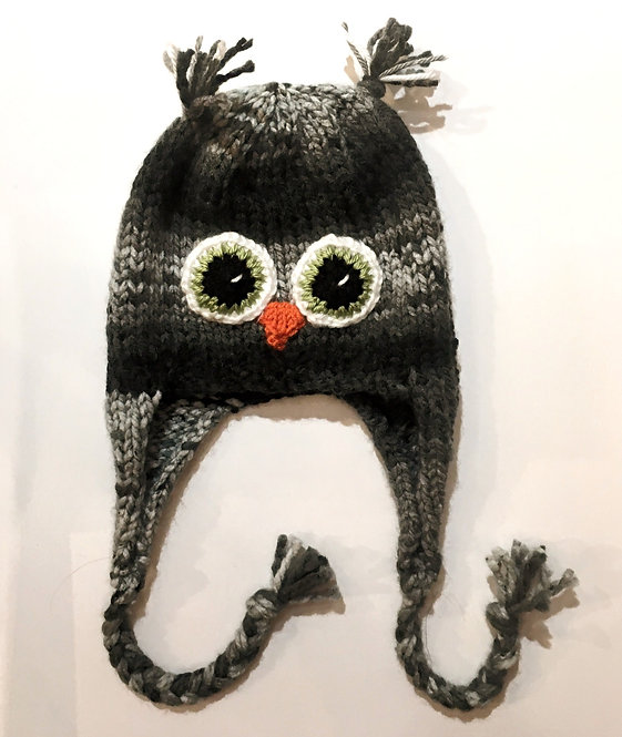 Black & gray knit childs hat with earflaps & chin ties-owl eyes & beak stitched on-ear tassels at top of crown