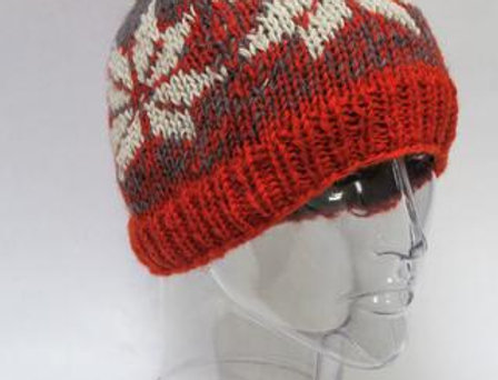 Orange & gray knit wool hat with pompom & white snowflake pattern around head