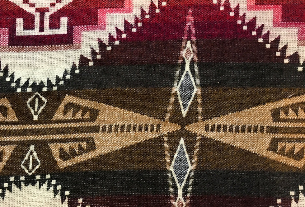 Close up of red, white & blue patterned blanket