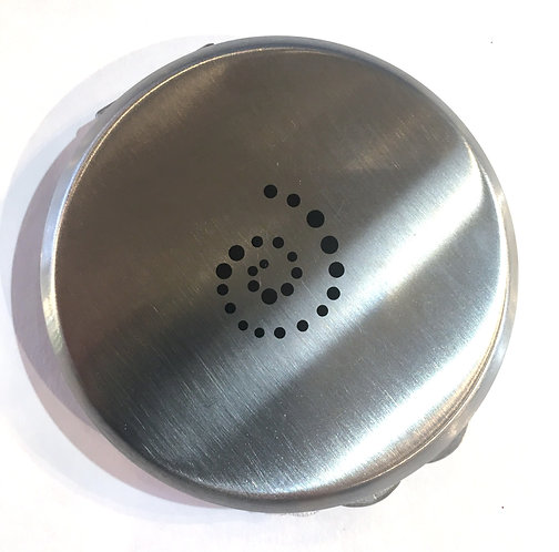 Top view of round metal storage case with black dots in swirl pattern