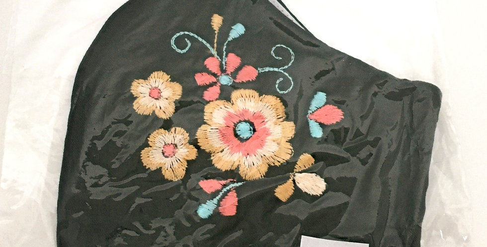 Side view of folded embroidered green mask with peach, yellow & sky blue flowers
