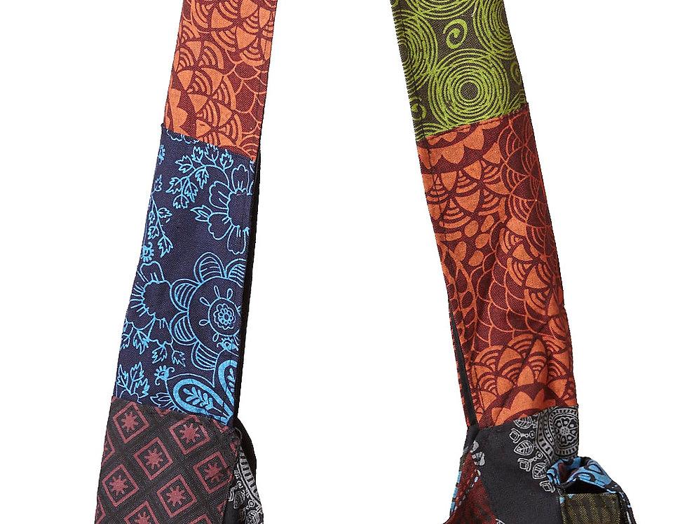 close up Ark Fair Trade Petite Patch Shoulder Bag-wide cloth-strap-wood button-zip front pouch-side pouch-multi color patch
