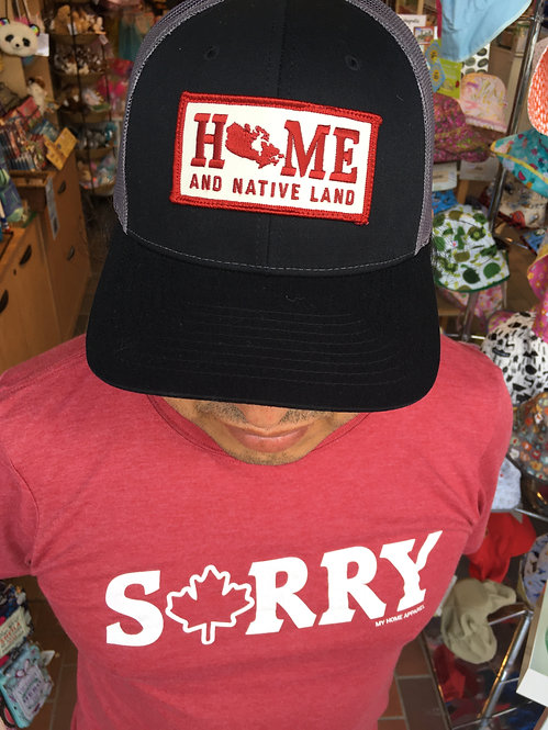 top view of man wearing Home and Native Land Truckers Cap