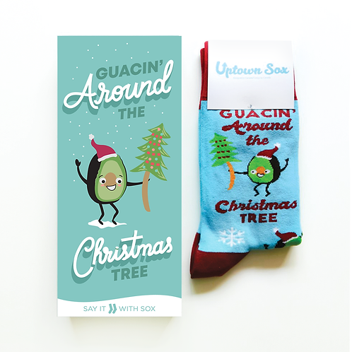Blue card with dancing avocado in santa hat text 'Guacin' around the Christmas Tree & pair of matching socks