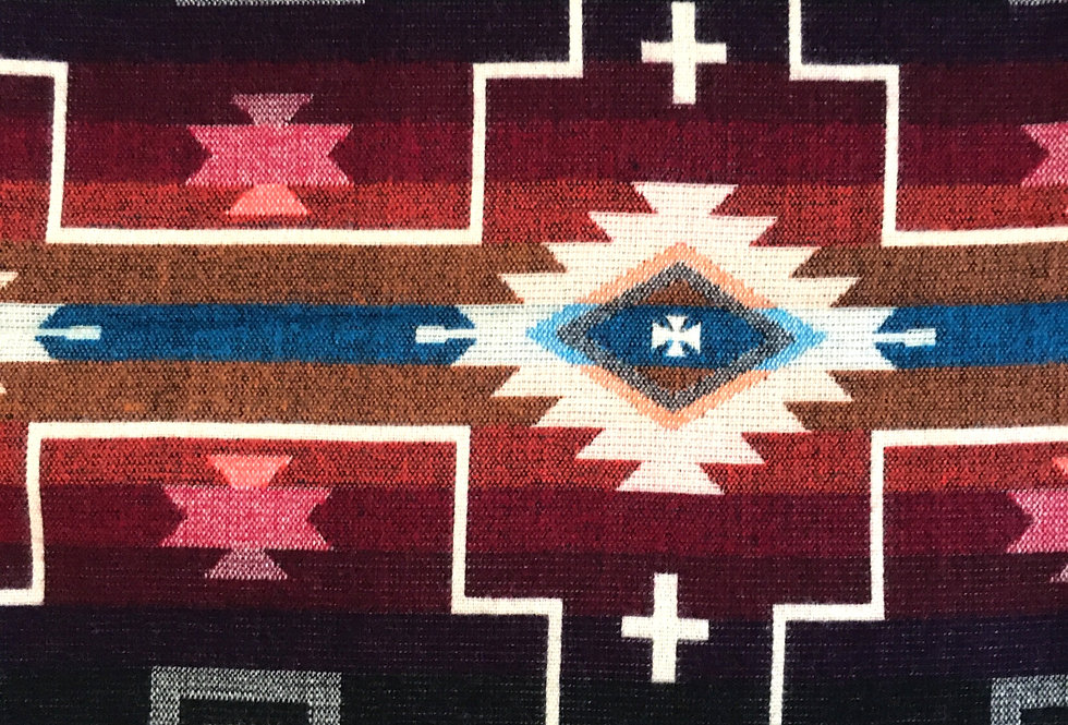 Close up of multi-colored aztec patterned blanket