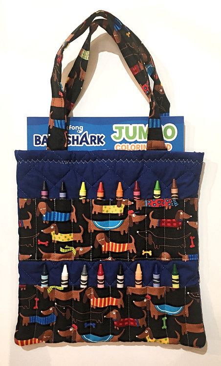 Flat rectangular navy cotton tote bag holding a crayon book & 16 slots for crayons on the front