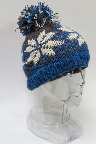 Blue & gray knit wool hat with pompom & white snowflake pattern around head